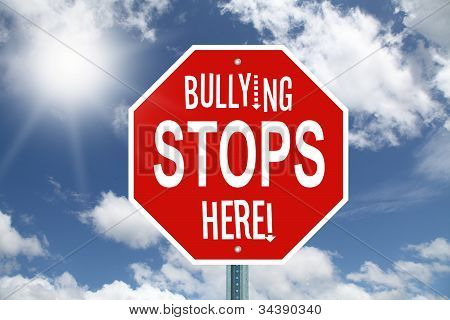 Red bullying stops here stop sign with white text on a cloud background