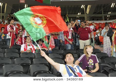 Fan Waving The National Flag Of Portugal