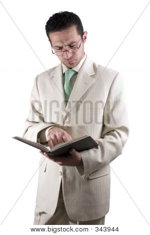 Businessman With A Pair Of Glassed Reading A Book