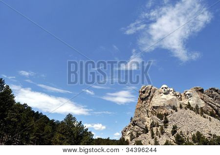 Tilted view of Mount Rushmore National Memorial in South Dakota, featuring sculptures of former U.S. presidents George Washington, Thomas Jefferson, Theodore Roosevelt and Abraham Lincoln.