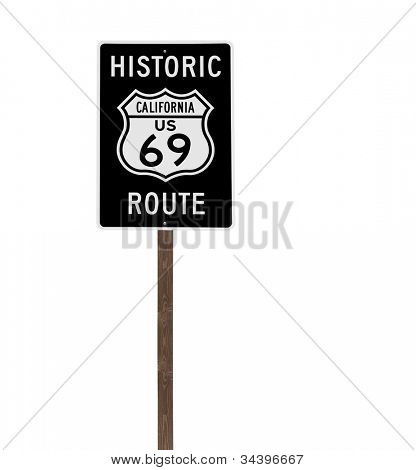 Tall isolated historic route 69 sign on a wood post.