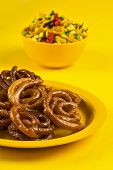 Jalebi And Traditional Indian Deep Fried Salty Dish Called Chivda Or Mixture Or Farsan poster