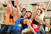 foto of dancing  - young people dancing in a studio or gym doing sports or practicing a dance number - JPG