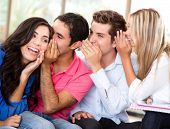 stock photo of hush  - Group of students gossiping at the university - JPG