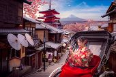 Photo Concept For Japan Travel In Sakura Or Cherry Blossom Season With Japanese Girl And Kimono, Thi poster