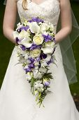 image of teardrop  - bride holding a large teardrop wedding bouquet - JPG