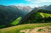 Beautiful Spring Landscape With Alpine Meadows And Snowy Mountains In Slovenia. Logarska Dolina And  poster