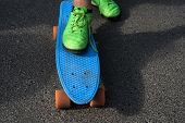 Summer Activities. Male Sport Shoe Standing On Blue Penny Board On Summer Day. Enjoying Summer Sport poster