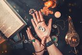 Astrology And Esotericism. The Witch Is Holding In His Hands The Rune Stones. Hands Close Up. On A B poster
