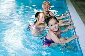 Mother With Two Daughters Having Fun In Indoor Swimming-pool. poster