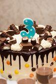Chocolate Birthday Cake For A Third Birthday Or Anniversary Celebration. Number Three Birthday poster