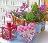 stock photo of pot-bellied  - Decoration of balcony hyacinths bellis and primrose Spring flowers on a balcony - JPG
