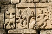 picture of bestiality  - Ancient Khmer carving showing cattle being abducted and assaulted.  Outer wall of Baphuon Temple, part of the Angkor Thom complex in Cambodia.  