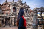 Young Girl Standing Infront Of A Sacred Buddhist Monastery. Sculptures Of Gods And Goddesses Carved  poster