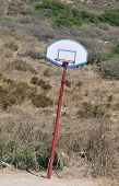 foto of oddities  - derelict leaning basketball basket in abandoned field - JPG