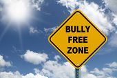 stock photo of disrespect  - Yellow bully free zone road sign on a beautiful sky background - JPG