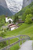 Church In Lauterbrunnen Valley, Switzerland. Idyllic Landscape poster