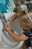 Toddlers Wash Their Hands In A Washstand In Kindergarten. Concept Of Hygiene, Professional Childcare poster