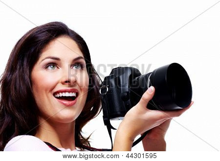 Woman with a photo camera. Isolated on white background.