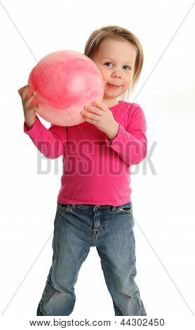 Young Girl Playing With A Toy Ball
