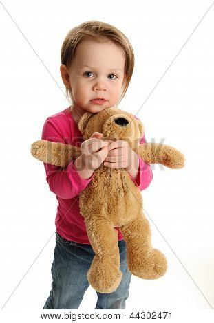Scared Girl Holding A Teddy Bear