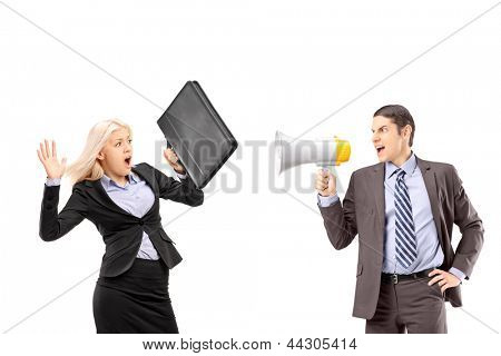 An afraid businesswoman and her manager shouting with a speakerphone isolated on white background