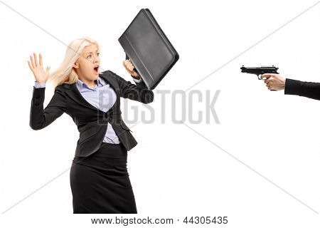 Afraid businesswoman from a gun isolated on white background