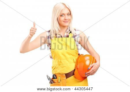 A female construction worker with equipment giving thumb up isolated on white background