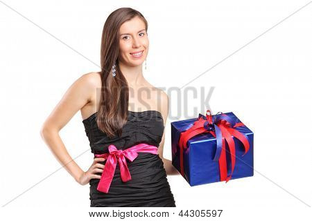 An attractive smiling woman holding a gift isolated on white background