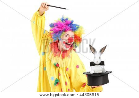 A circus clown performing a magic trick with a top hat and a rabbit isolated on white background