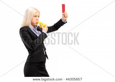 Young businesswoman blowing a whistle and showing a red card, isolated on white background