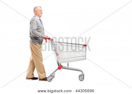 Full length potrait of a gentleman walking and pushing an empty shopping cart isolated on white background
