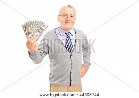 Smiling senior gentleman holding money, isolated on white background