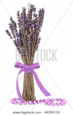 Lavender herb flower posy with lilac bead strand over white background.