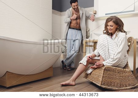 Young beautiful couple in the bathroom