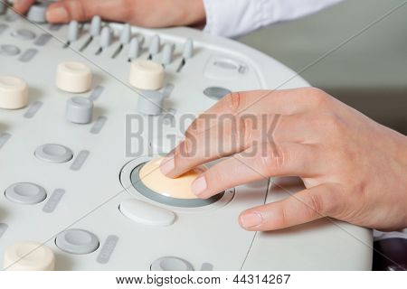 Close up of female radiologist operating ultrasound machine