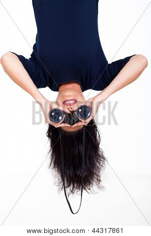 upside down photo of young woman holding binoculars