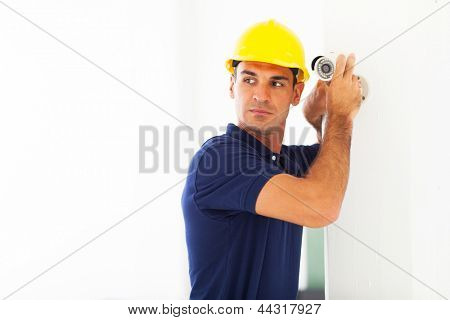 professional cctv technician adjusting security camera angle