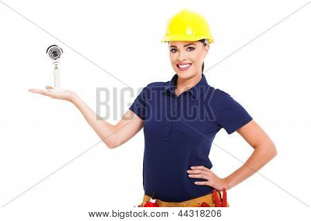 pretty female cctv installer presenting camera on white background