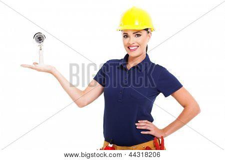 pretty female cctv installer presenting camera on white background