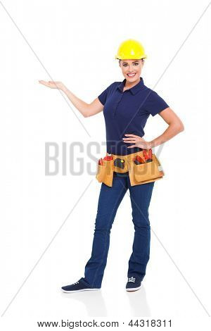 pretty handywoman presenting on white background