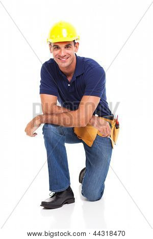 happy male constructor kneeling over white background