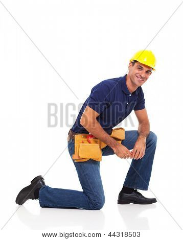 portrait of handyman kneeling over white background