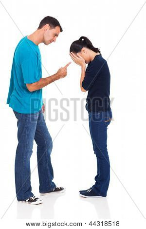 angry man pointing his crying girlfriend isolated on white background