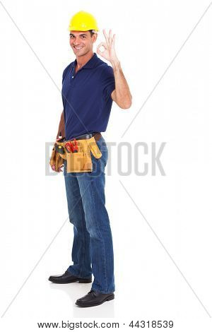 full length of handyman giving ok sign on white