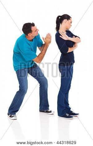 man begging his angry wife over white background