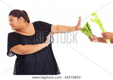 overweight teen girl refuse to have vegetables