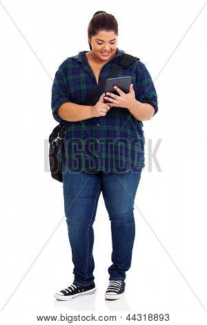 full length of plus size college student with tablet computer over white background