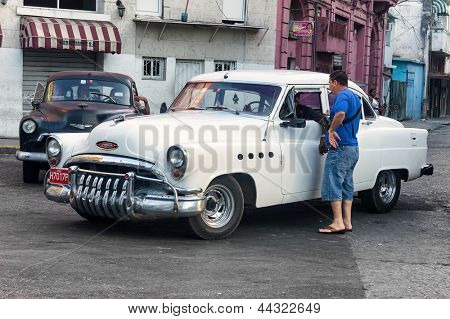 HAVANA-APRIL 4:Vintage Buick used as a taxi April 4,2013 in Havana.Thousands of these classic cars are still used for public transportation in Cuba, operated mainly by private drivers