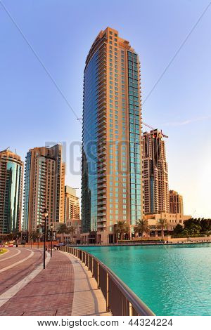 DUBAI, UAE - OCTOBER 23: Modern skyscrapers in Dubai on October 23, 2012 in Dubai, UAE. Dubai now boasts more completed skyscrapers higher than 0,8 - 0,25 km than any other city